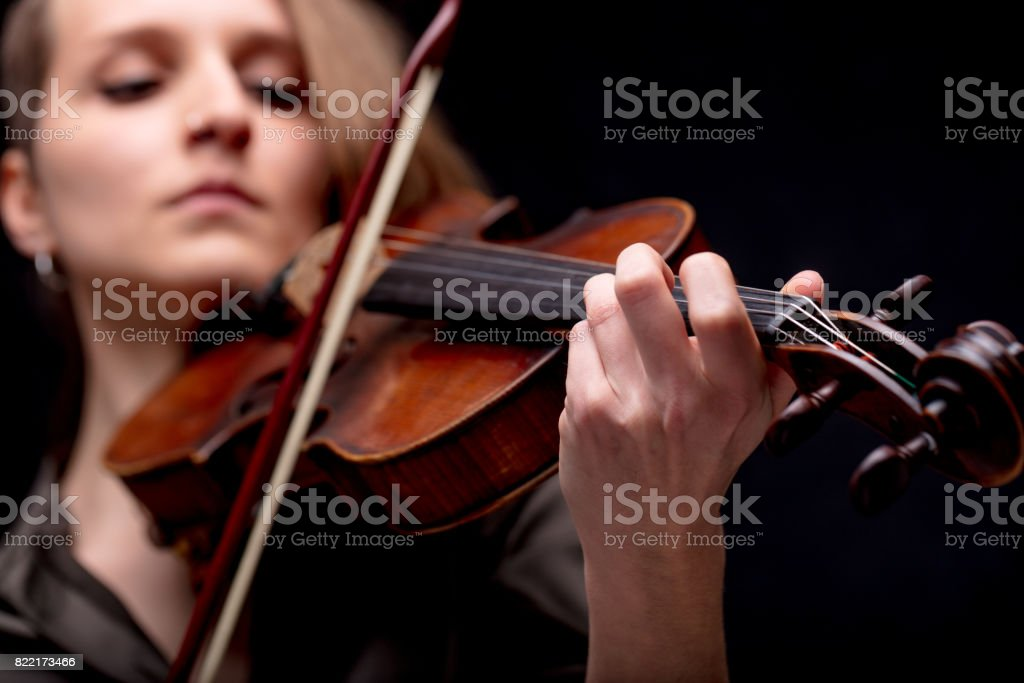 hand closeup of a violinist on black stock photo