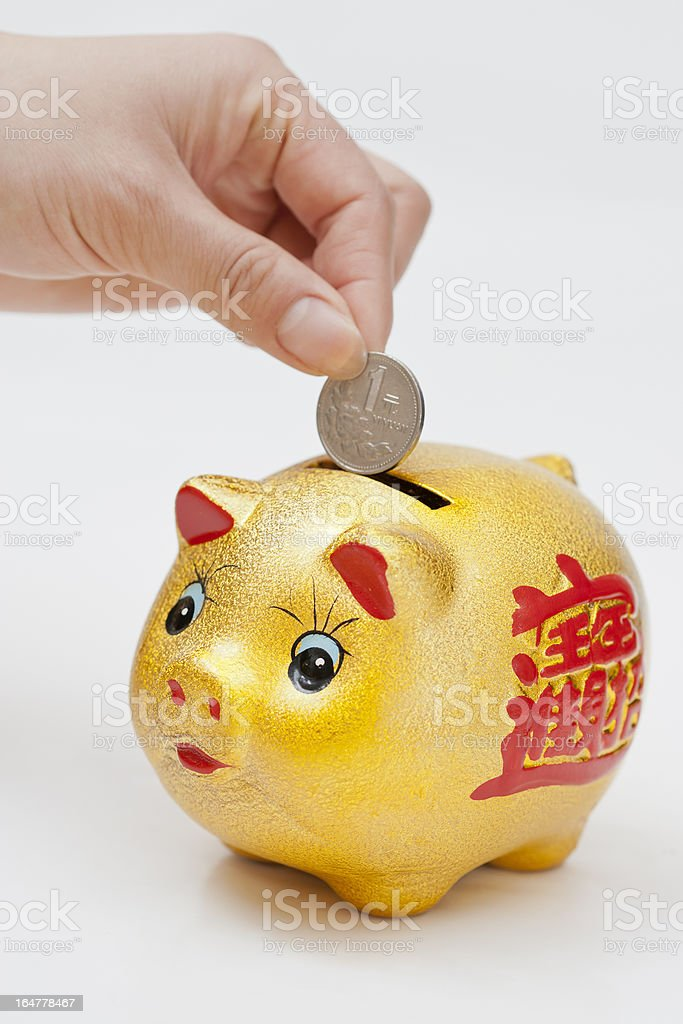 Hand coin piggy bank royalty-free stock photo