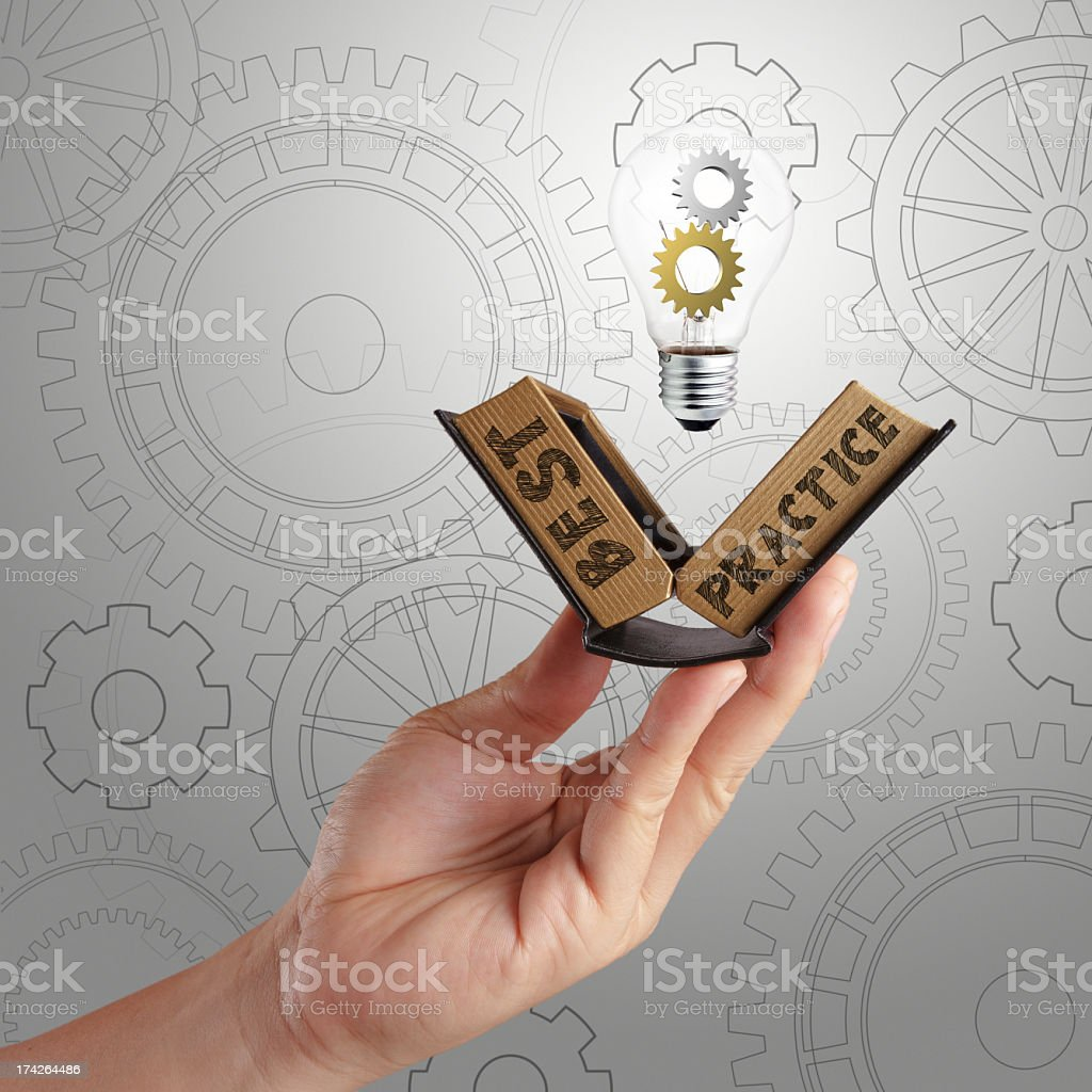A hand collecting best practice ideas to solve problems stock photo