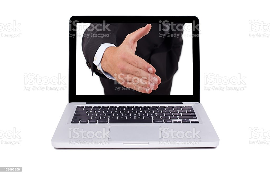 Hand coming out from the screen of laptop royalty-free stock photo