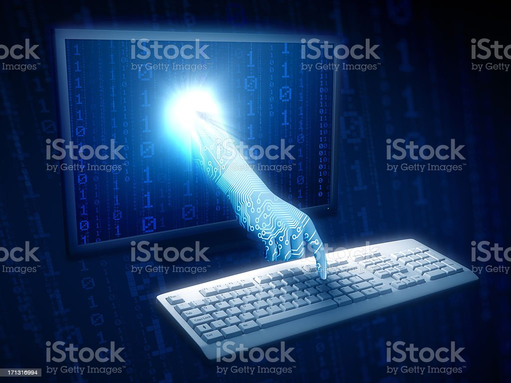 Hand coming through monitor typing on keyboard stock photo