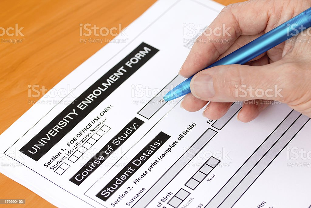 Hand Completing a University Application Form stock photo