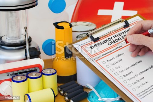 174913696 istock photo Hand completing Emergency Preparation List by Equipment 176990809