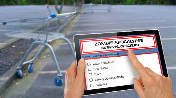 hand completing zombie apocalypse survival checklist on a computer tablet - zombie apocalypse stock photos and pictures