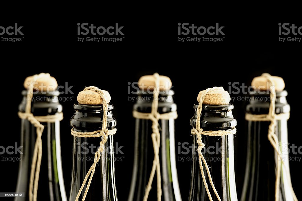 Hand corked and tied champagne bottles stock photo