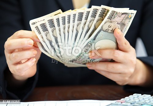 istock Hand counting money, Japanese currency note , Japanese yen 518815055