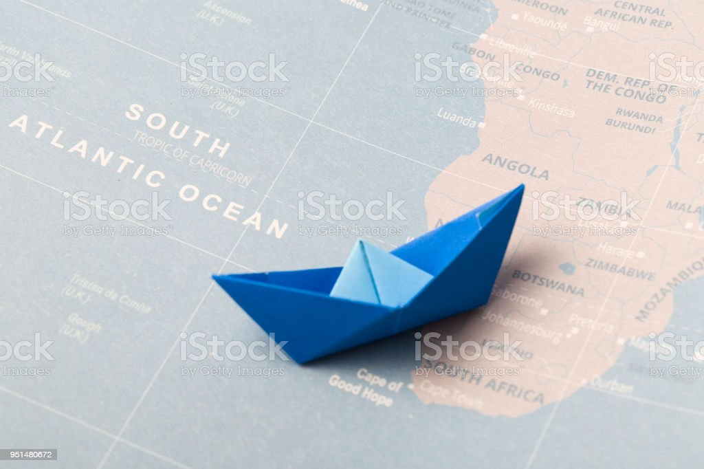 Hand Crafted Paper Boat On Worldmap Background Stock Photo More