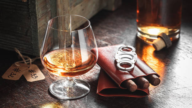 Hand crafted whisky and cigar in the distillery warehouse stock photo