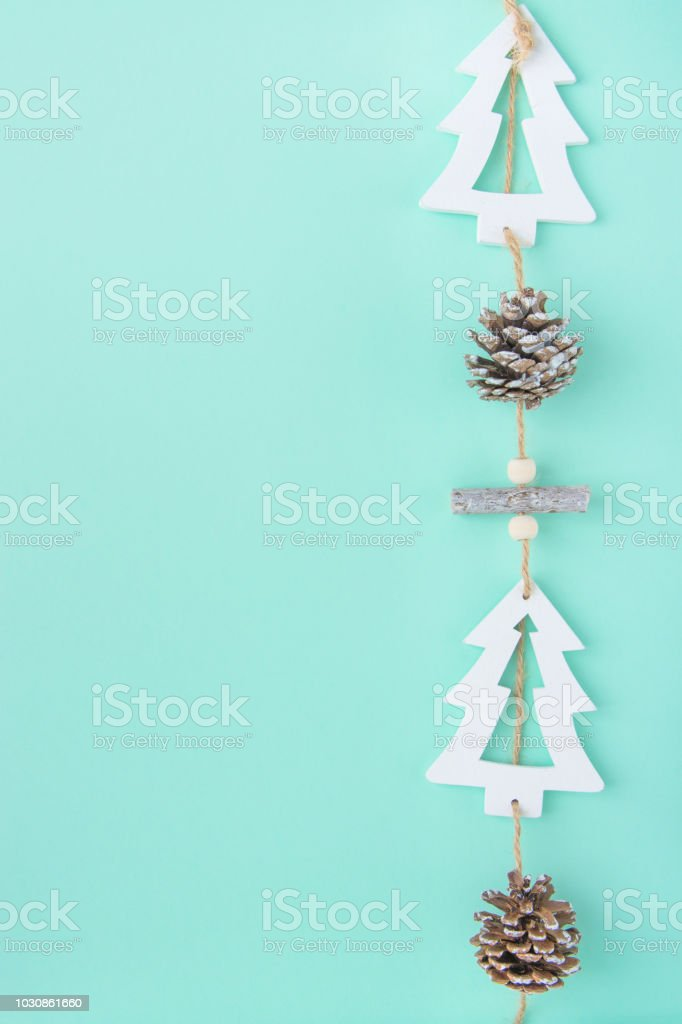 Hand Crafted Wood Christmas Tree Ornament Hanging On Twine With Pine Cone On Turquoise Background Scandinavian Style Festive Cozy Atmosphere Copy Space Poster Card Poster Banner Stock Photo Download Image Now
