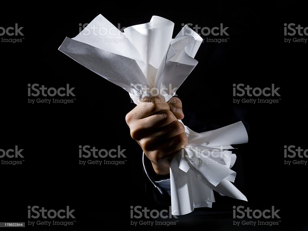 Hand crushing a paper royalty-free stock photo