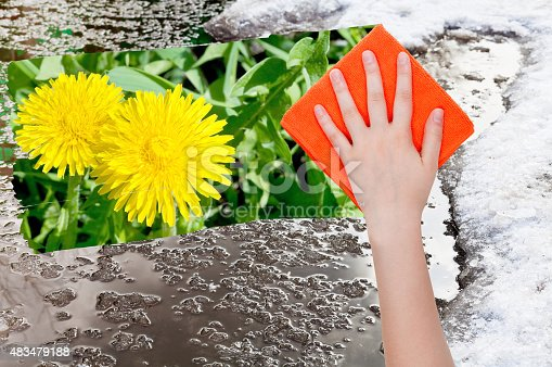 639394370istockphoto hand deletes melting snow by orange cloth 483479188