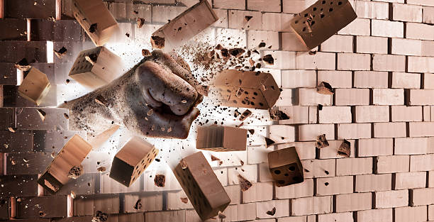 hand destroy wall - strength at max power - punching stock photos and pictures