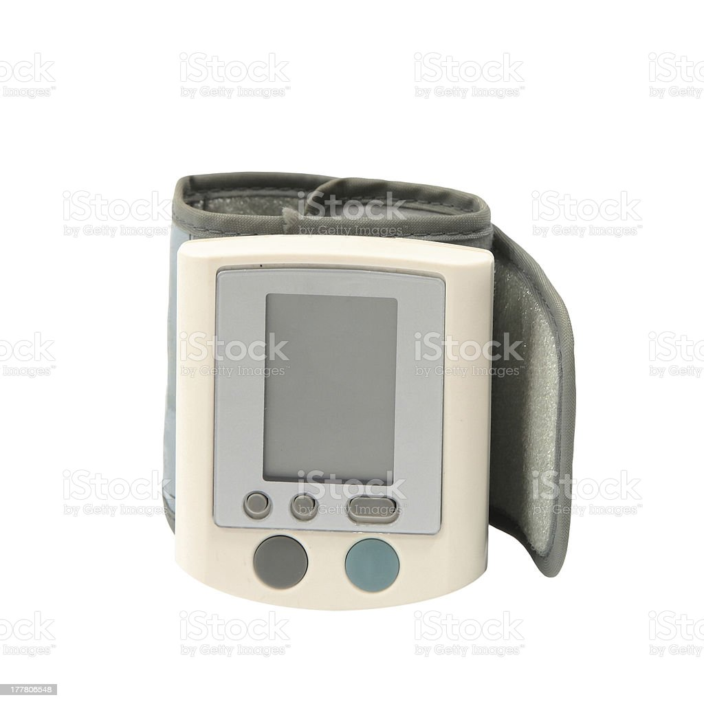 Hand Digital blood pressure monitor isolated royalty-free stock photo