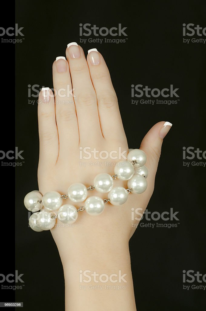 Hand Display with Pearls Isolated on Black royalty-free stock photo
