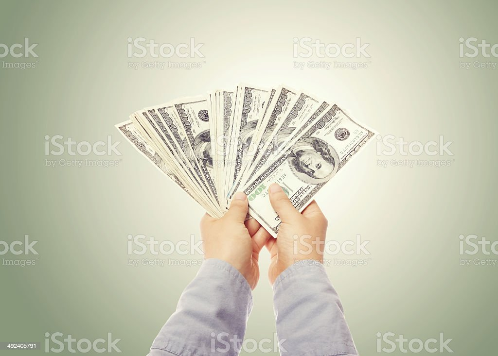 Hand Displaying a Spread of Cash stock photo