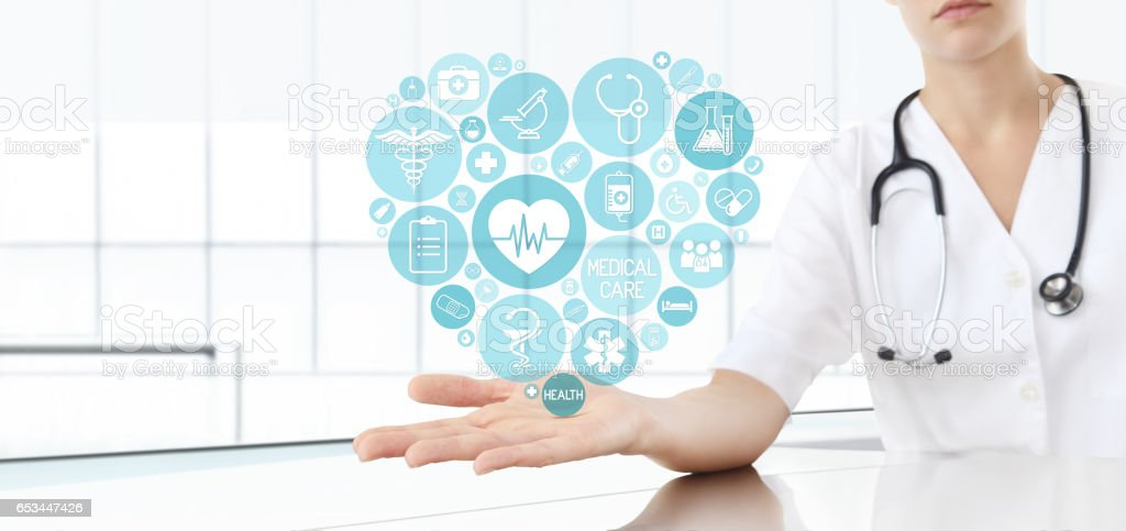 hand doctor with medical heart icons stock photo