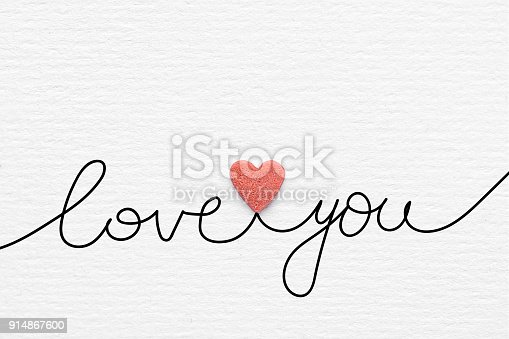 istock Hand Doodle Calligraphic Lettering Love You Red Sugar Candy Sprinkles Heart on White Watercolor Paper Background. Creative Mixed Media Greeting Card for Valentines Mother's Day Engagement. 914867600