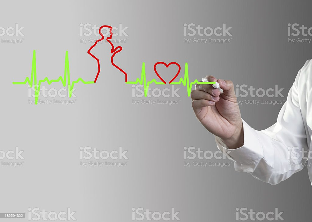 Hand drawing a cardiogram heartbeat wave and a person stock photo