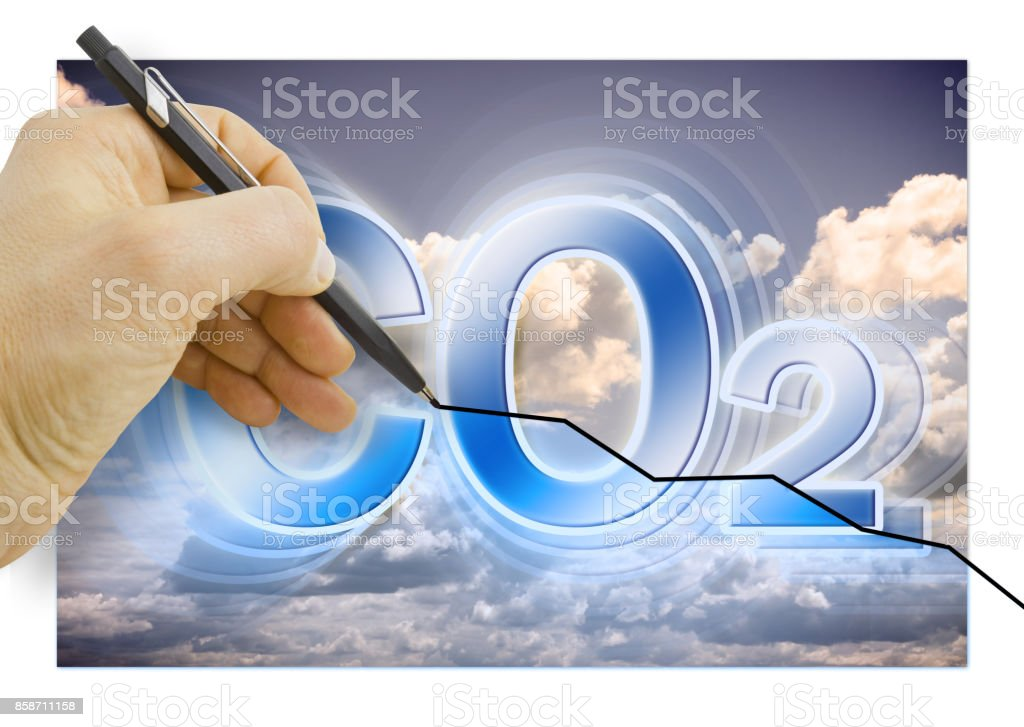 Hand drawing a graph about Reduction of CO2 presence in the atmosphere - concept image stock photo