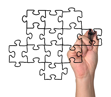 Hand Drawing A Jigsaw On A Clear Screen Stock Photo - Download Image Now