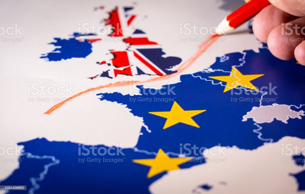 Hand drawing a red line between the UK and the rest of EU, Brexit concept. stock photo