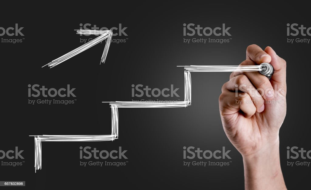 Hand drawing a stairs in a Conceptual Image stock photo