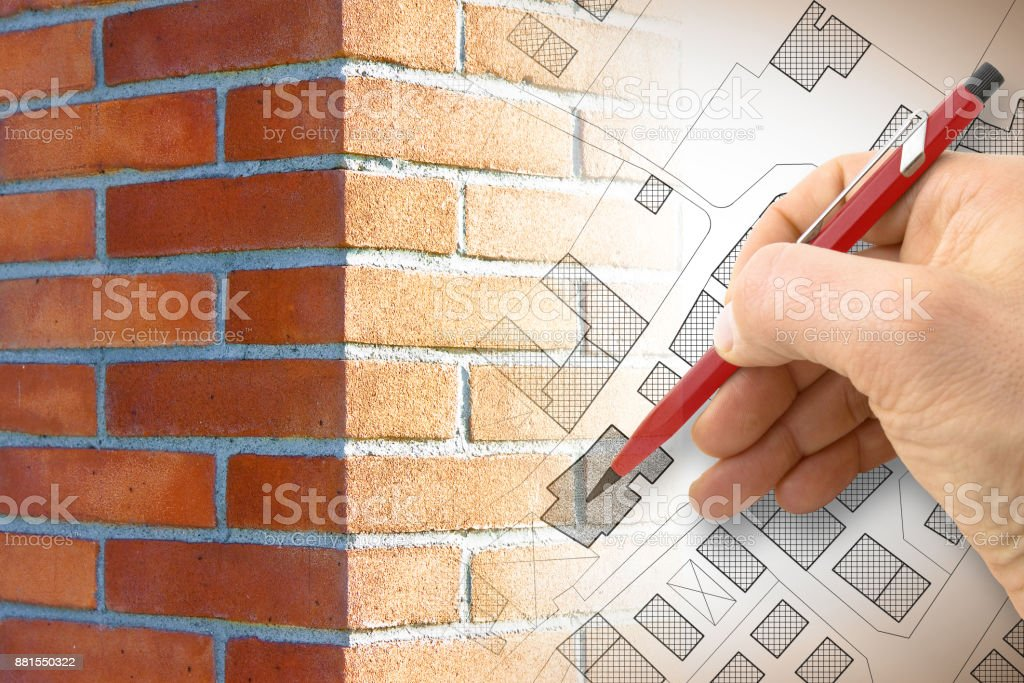 Hand drawing an imaginary cadastral map of territory with buildings, roads and brick wall on foreground stock photo