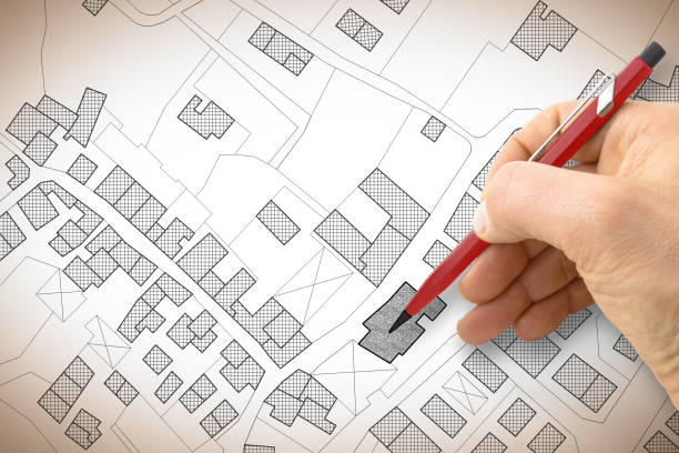 Hand drawing an imaginary cadastral map of territory with buildings and roads stock photo