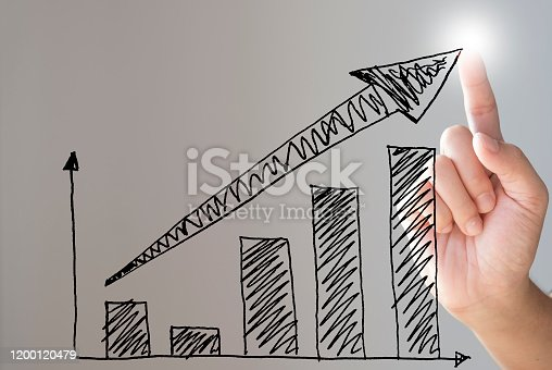 Hand drawing bar chart and rising arrow for economic business growth.