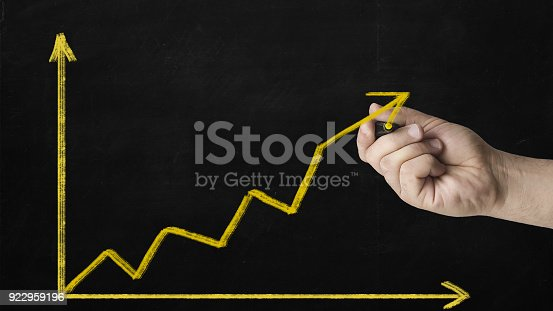 istock hand drawing business chart on a blackboard symbolizing growth 922959196