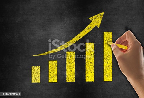 527033580 istock photo Hand Drawing Business Graph on Blackboard Background 1162158871
