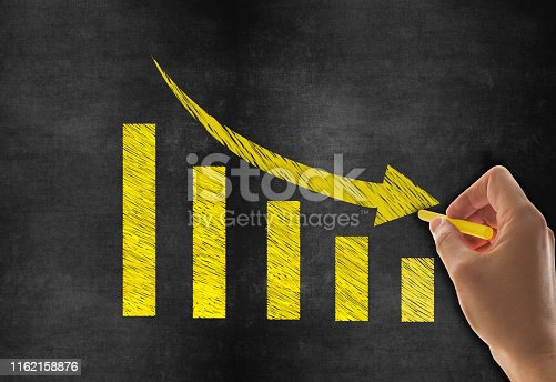 Hand Drawing Business Graph on Blackboard Background