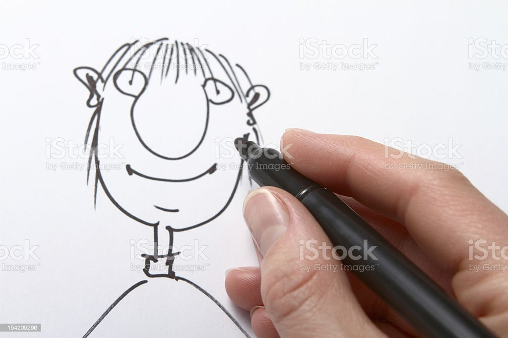 Hand drawing caricature with black pen stock photo