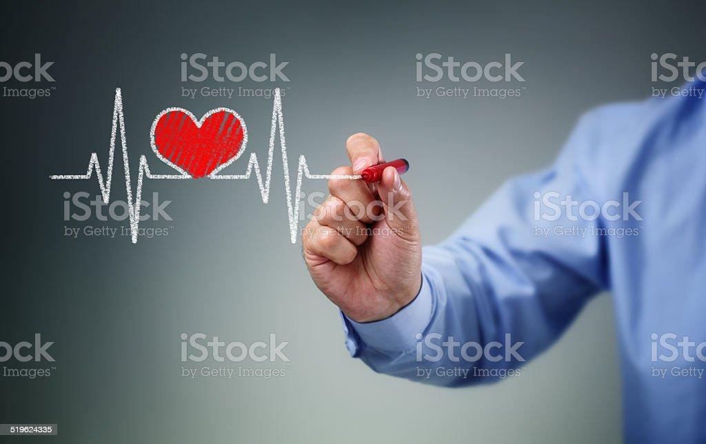 Hand drawing heartbeat stock photo
