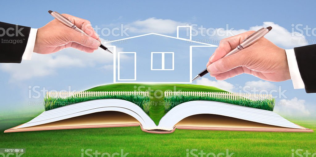 hand drawing home on green meadow stock photo