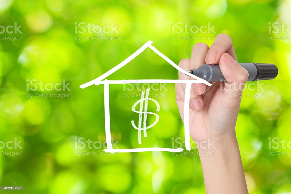Hand drawing house and dollar sign with green bokeh effect stock photo