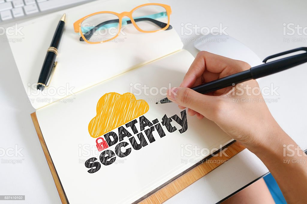 hand drawing on note book with DATA SECURITY  text stock photo