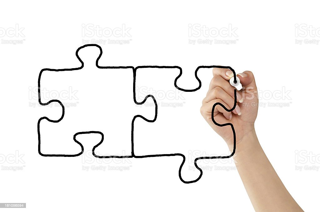 A hand drawing puzzle pieces royalty-free stock photo