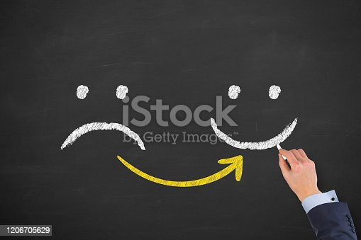 517629622 istock photo Hand Drawing Unhappy and Happy on Blackboard Background 1206705629