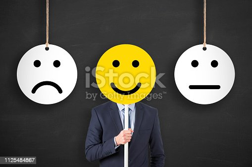 istock Hand Drawing Unhappy and Happy on Blackboard 1125484867
