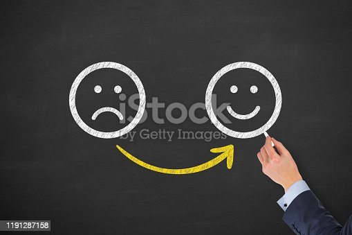 517629622 istock photo Hand Drawing Unhappy and Happy on Blackboard 1191287158