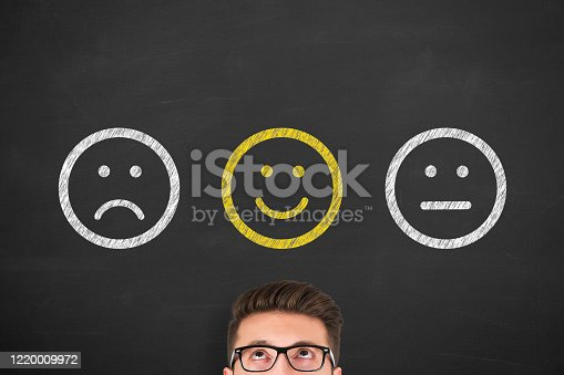 622323384 istock photo Hand Drawing Unhappy and Happy on Blackboard 1220009972