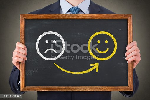 622323384 istock photo Hand Drawing Unhappy and Happy on Blackboard 1221508202