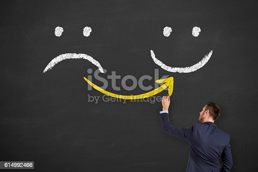 istock Hand Drawing Unhappy and Happy Smileys Concept 614992466