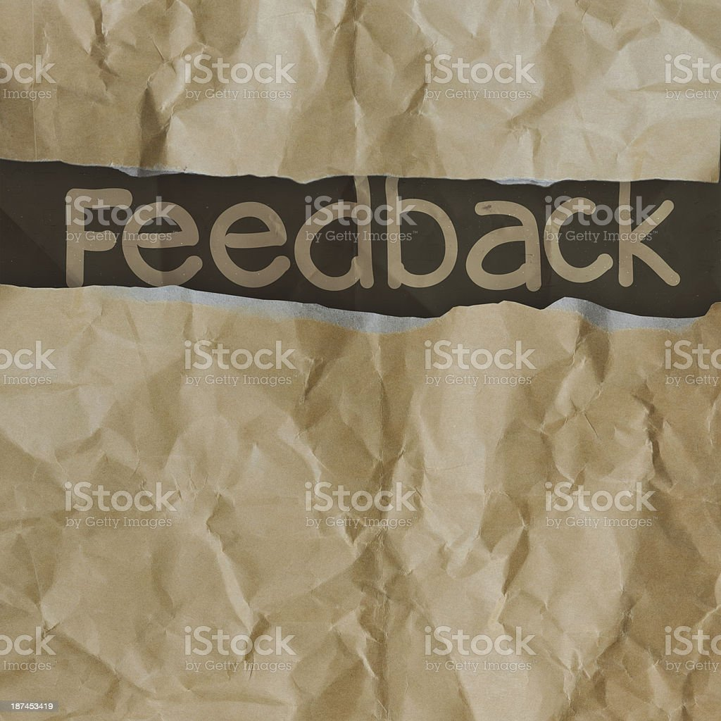 hand drawn feedback  words on crumpled paper with tear envelope royalty-free stock photo