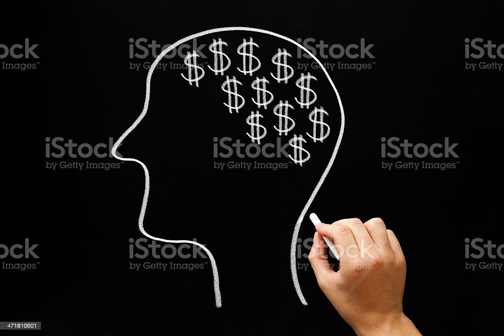A hand drawn head of a man with dollar signs on a board royalty-free stock photo