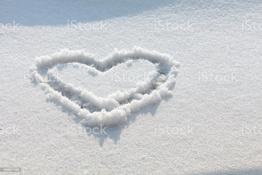Hand drawn heart in the snow stock photo