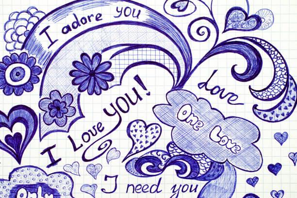 hand drawn love doodles messages on checkered paper. - scarabocchio disegno foto e immagini stock