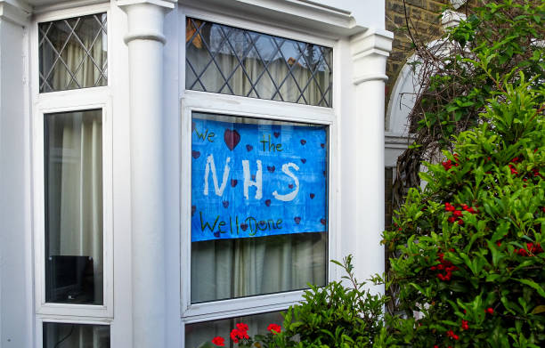 Hand drawn poster with thank you note to NHS (National Health Service) displayed at house in Lewisham, during coronavirus covid-19 outbreak. stock photo