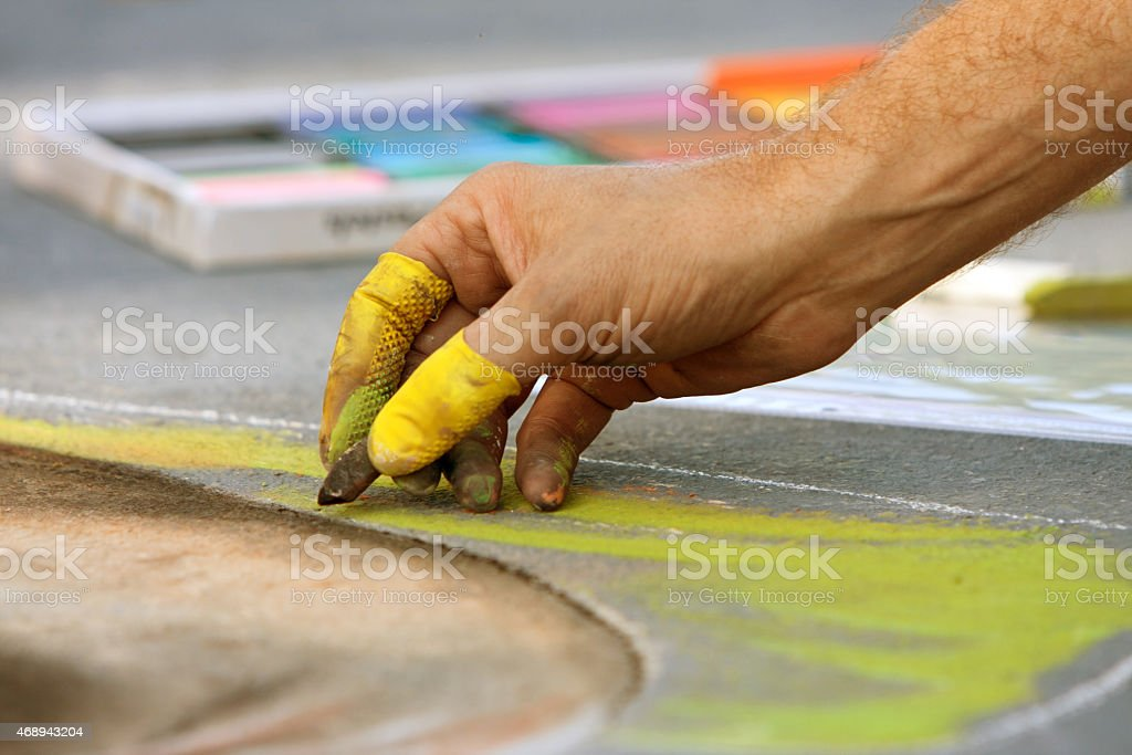 Hand Draws Chalk Art At Fall Festival Closeup of hand drawing chalk art at fall festival 2015 Stock Photo
